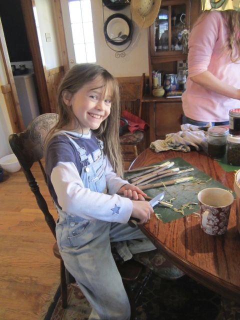 Hannah carving Sumac spiles. I have never seen her when she wasn't smiling.