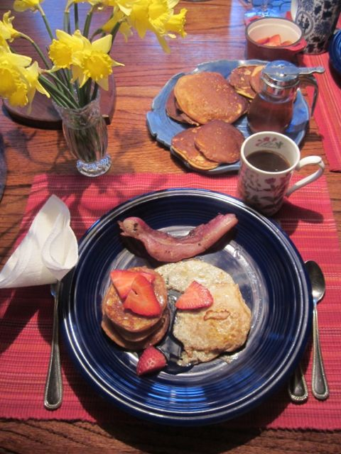 Jason and I have been trying to eat gluten free for the past few years. These banana almond butter egg paleo pancakes are our favorites. The Maple syrup is so delicious! As we ate dinner we had daffodils on the table but snow quietly falling outside the windows.